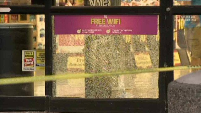 A bullet shattered this window at the Fry's store. (Source: CBS 5 News)