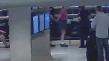 Surveillance video shows officers arresting Steinmetz at Sky Harbor. (Source: Phoenix Police Department)