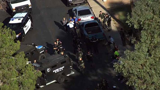 Police and SWAT members converged at 213 E. Bruce in Gilbert to serve a warrant during a drug and stolen property investigation Wednesday morning. (Source: CBS 5 News)