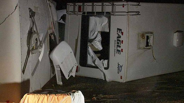 Some people had to cut from their trailers after a microburst overturned several of them at an RV park in Buckeye on Thursday. (Source: CBS 5 News)