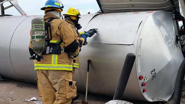 Crews cut into the tanker that rolled after the crash. (Source: Arizona Department of Public Safety)