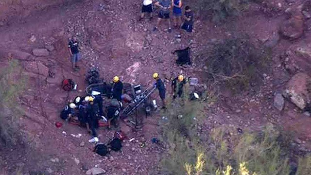 Phoenix firefighters and rescue crews work to rescue three people injured in a fall on Camelback Mountain on Friday. (Source: CBS 5 News)
