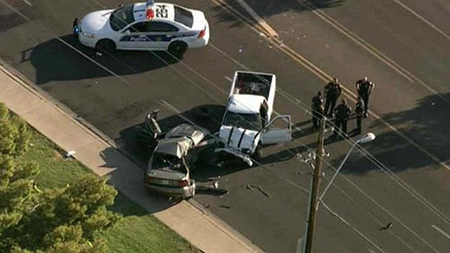 A 6-year-old child and a 53-year-old woman have died after this two-vehicle crash on Aug. 8. (Source: CBS 5 News)