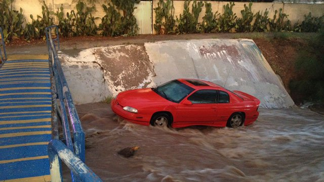 A flooded wash swept a car downstream. (Source: Tucson Fire Department)