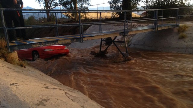 Rushing water was almost up to the windshield. (Source: Tucson Fire Department)
