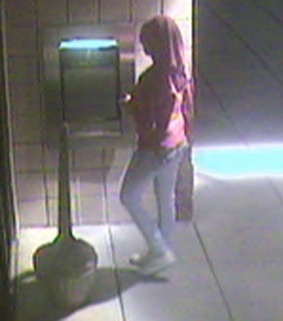 The woman was caught on surveillance camera used a stolen bank card, officers said. (Source: Silent Witness)