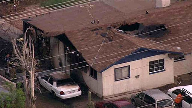 Fire badly damage the carport and attic of this Mesa home Monday morning. (Source: CBS 5 News)