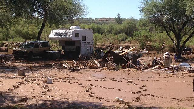 Residents of the The River's Edge RV Park in Black Canyon City were forced to evacuate when runoff swelled a creek and river that overflowed their banks Tuesday. (Source: CBS 5 News)