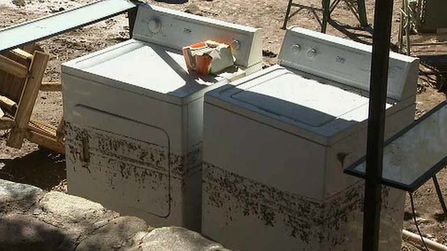 Sanders' washer and dryer were among the damaged items. (Source: CBS 5 News)