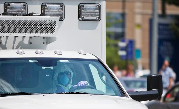 An ambulance transporting an American missionary stricken with Ebola, arrives at Emory University Hospital, in Atlanta, Ga., Aug. 5, 2014. (Source: David Goldman/AP)
