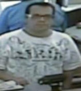 Surveillance image of suspect. (Source: Surprise Police Department)