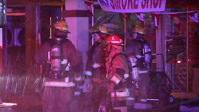 Fire crew had to battle flames, rain, winds and live downed power lines at a Phoenix strip mall Thursday night. (Source: CBS 5 News)