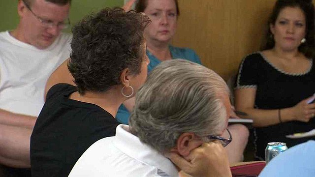 'They're charging a hell of a lot of money for these houses and you're not telling these people they're going to get a surprise of a lifetime,' a woman said at an Aug. 18 forum in Fire Department 57's station. (Source: CBS 5 News)