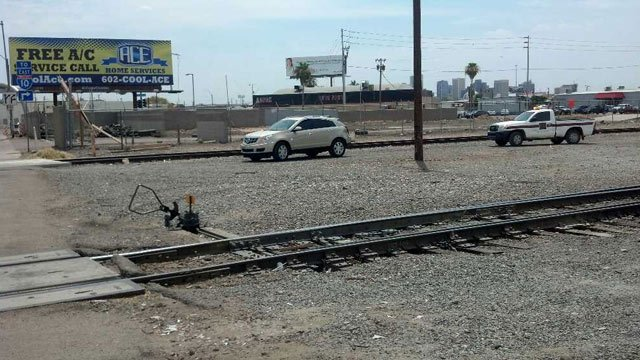 The rear bumper of this car was ripped off by a passing train at a Phoenix crossing Tuesday. (Source: CBS 5 News)