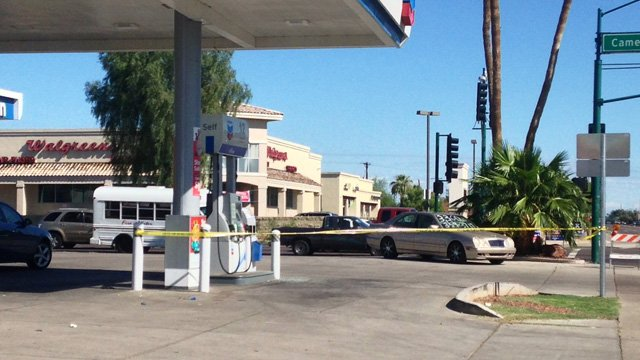 The scene at  a Phoenix convenience store where the shooting happened was still taped off Sunday morning. (Source: CBS 5 News)