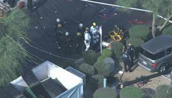 Firefighters wore full hazmat suits as they worked the scene. (Source: CBS 5 News)