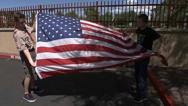 Kyle Tucker, 16, left, had an American flag donated to him by the American Legion. It's supposed to go up at the Arizona Agribusiness and Equine Center in Avondale. (Source: CBS 5 News)