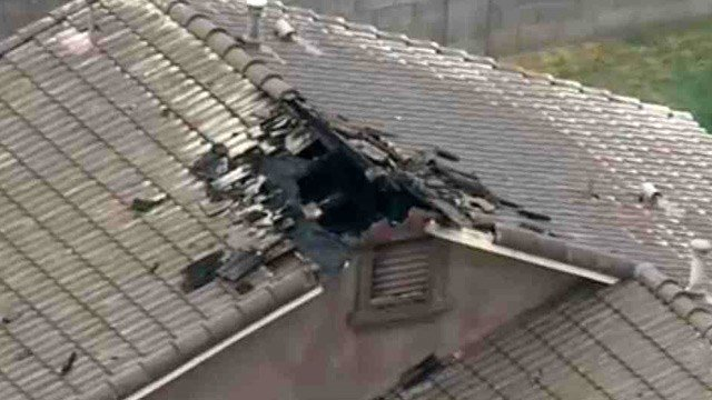 The homeowner said a gaping hole in the roof of this Tolleson is believed to have been caused by a lightning strike and ensuing fire. (Source: CBS 5 News)