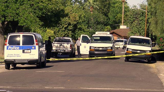 The medical examiner's van was at the scene of the shooting Tuesday morning. (Source: CBS 5 News)