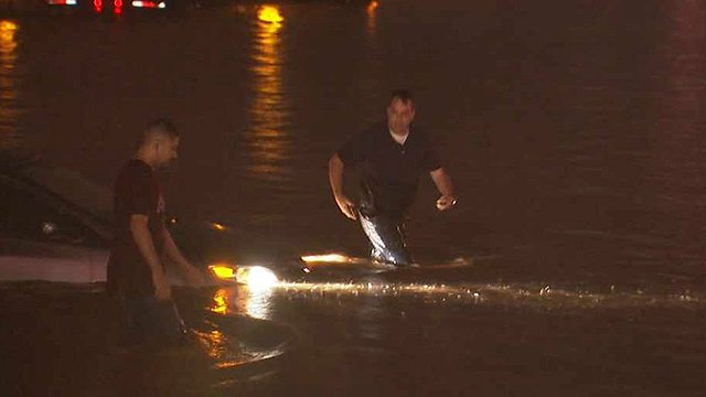 Jim Sampson walks from his car that was caught in floodwaters on Interstate 10 near 43rd Avenue. (Source: CBS 5 News