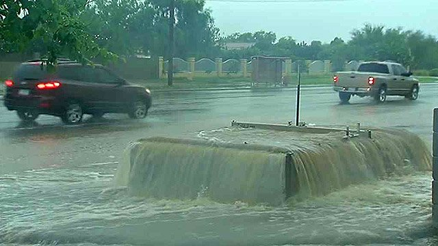 Water gushes after Monday's record rainfall. (Source: CBS 5 News)