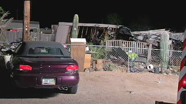 An early-morning fire destroyed this mobile home in Apache Junction on Tuesday. (Source: CBS 5 News)