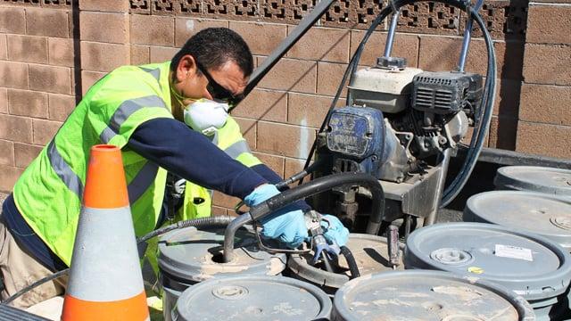 Rodriguez prepares a paint sprayer. (Source: City of Chandler)