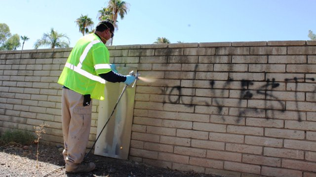 Rodriguez paints over graffiti in a Chandler. (Source: City of Chandler)