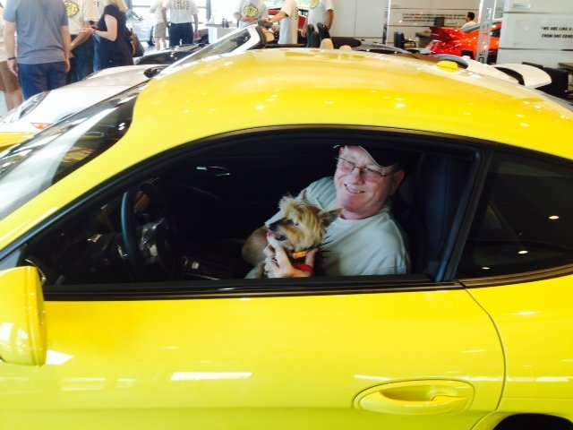 Porsche dealer Kevin Campbell with his dog co-pilot.