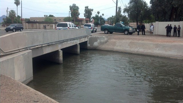 A 2-year-old boy pulled from this canal by a Phoenix police officer on July 25 has died. (Source: CBS 5 News)