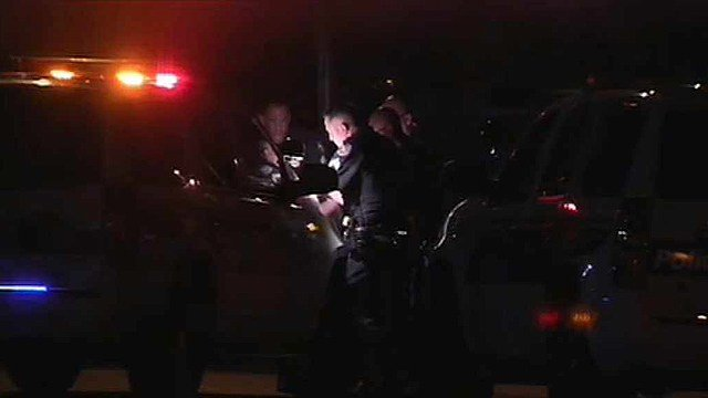 Phoenix police investigate an officer-involved shooting that resulted in the death of a machete-wielding man Monday night. (Source: CBS 5 News)