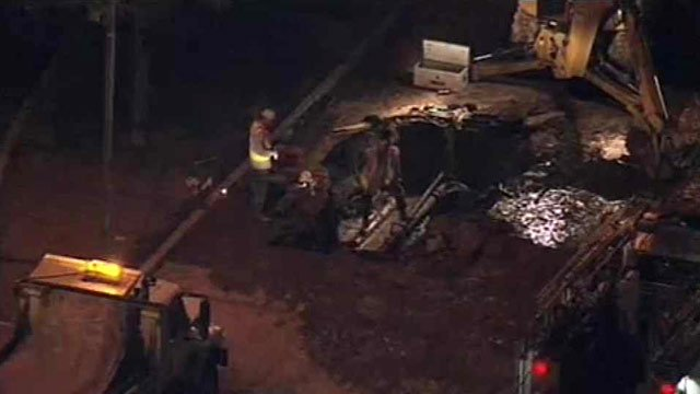 Crews work to repair a water main break on Broadway Road in Mesa. (Source: CBS 5 News)