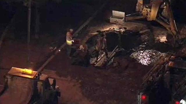 Crews work to repair a water main break on Broadway Road in Mesa. (Source: CBS 5 News)