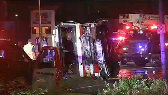 A Phoenix fire truck rolled onto its side after a collision in a Phoenix intersection early Friday morning. (Source: CBS 5 News)