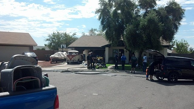 Glendale firefighters were able to limit damage from an attic fire at this Phoenix home Friday morning. (Source: CBS 5 News)