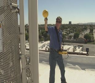 RF Engineer Marvin Wessel inspects a cell phone tower. (Source: CBS 5 News)