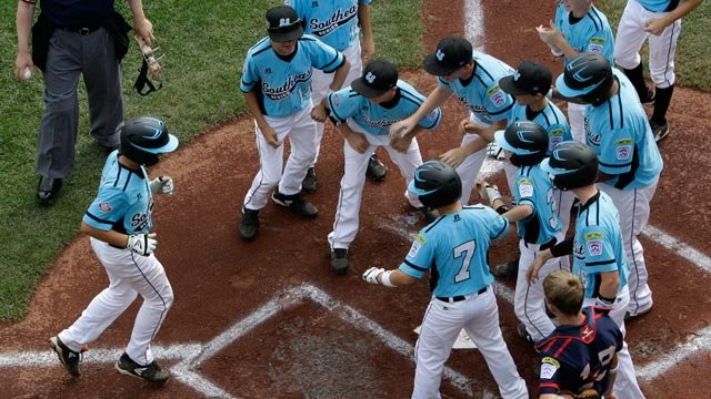 Zane Denton, left, of Nashville, TN, trots home after hitting a grand slam home run Monday at the Little League World Series in South Williamsport, PA. (AP Photo/Gene J. Puskar)