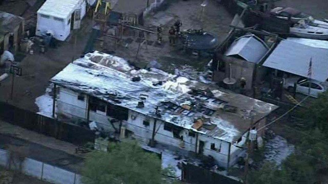 Fire destroyed this double-wide trailer in north Phoenix early Tuesday morning. (Source: CBS 5 News)