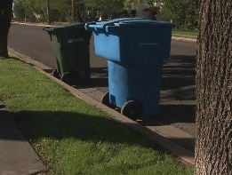 Trash cans at curb: proper placement. (CBS 5 News)