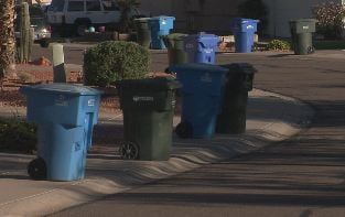 Trash cans on sidewalk: improper placement. (CBS 5 News)