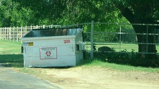 The duffel bag full or child pornography was found in this Dumpster outside a resident's home. (Source: Maricopa County Sheriff's Office)