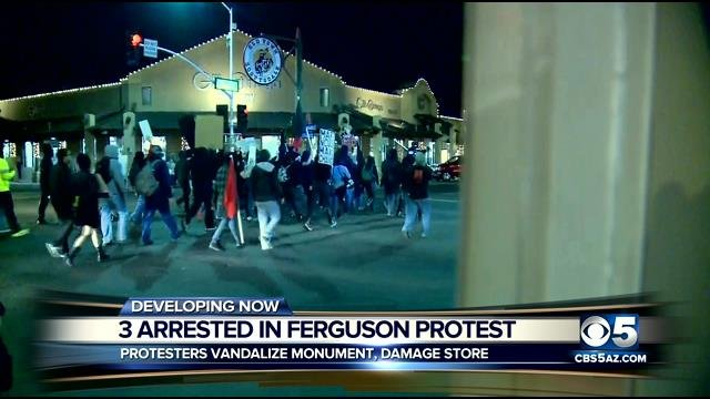 Three people were arrested. Two of them were bystanders who instigated a fight with some of the demonstrators, police said.  (Source: CBS 5 News)