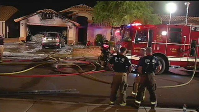 Chandler firefighters take a breather after extinguishing a garage fire Wednesday morning. (Source: CBS 5 News)