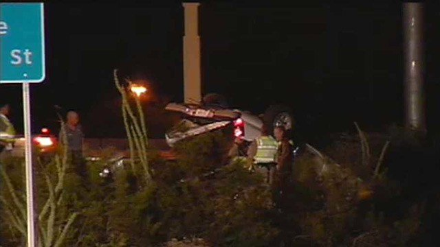 DPS investigators look at a pickup truck after a fatal rollover crash Friday morning. (Source: CBS 5 News)