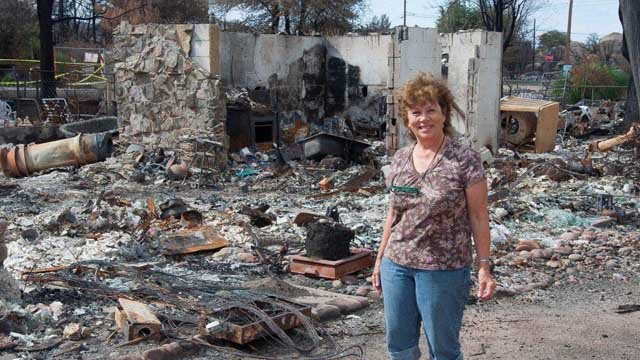 Carole Ryan in the debris at her home that was destroyed by the Yarnell Hill Fire. (Source: American Red Cross Grand Canyon Chapter)
