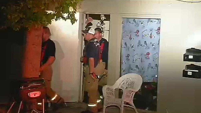 Phoenix firefighters leave an apartment that caught fire early Thursday morning. No injuries were reported. (Source: CBS 5 News)