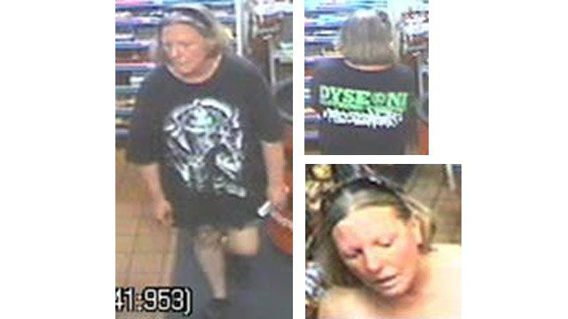 Phoenix police say this woman is suspected of trying to steal a purse out of the front seat of a car in a gas station parking lot in August. (Source: Phoenix Police Department)