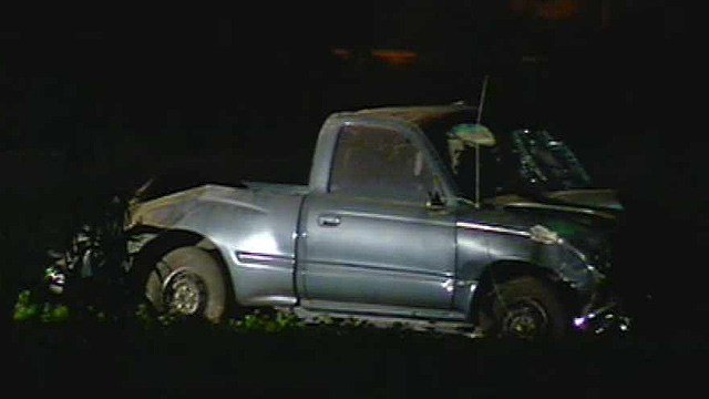 Rescue crews had to lift this truck off its driver after a crash on Grand Avenue near 70th Avenue early Monday. (Source: CBS 5 News)