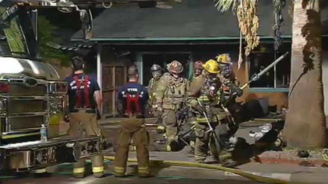 Scottsdale firefighters leave a house that caught fire early Tuesday morning. (Source: CBS 5 News)