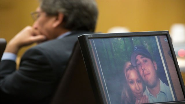 A photo of Arias and murder victim Travis Alexander was displayed on a computer screen during closing arguments. (Source: CBS 5 News)